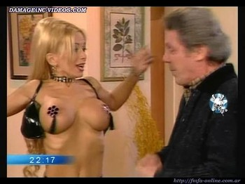 Dana Fleyser takes off her bra to show her boobs