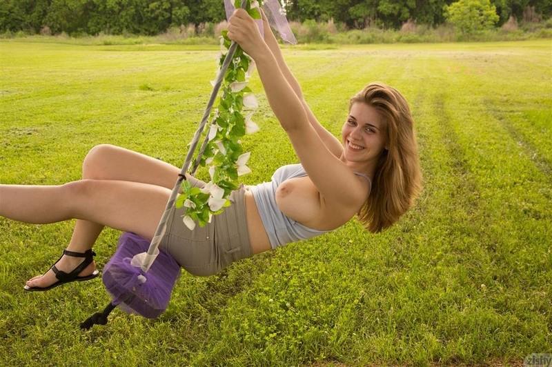 Flexible girl licks herself